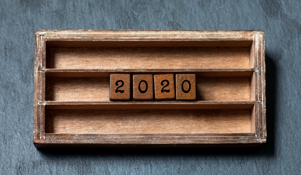 2020 new year retro style card. Two thousand and twentieth year number, wooden cubes in box shelf. 2020 year simplicity design greeting invitation. Gray stone background